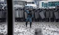 Ukrainian riot police line up in central Kiev on Monday